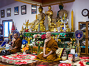 14 APRIL 2019 - DES MOINES, IOWA: Buddhist monks leads prayers during Lao New Year, also called Songkran,  observances at Wat Lao Buddhavath in Des Moines. Several thousand Lao people live in Des Moines. Most came to the US after the wars in Southeast Asia. Songkran is celebrated in Theravada Buddhist countries (Sri Lanka, Myanmar, Thailand, Laos, and Cambodia) and in Theravada Buddhist communities around the world.      PHOTO BY JACK KURTZ