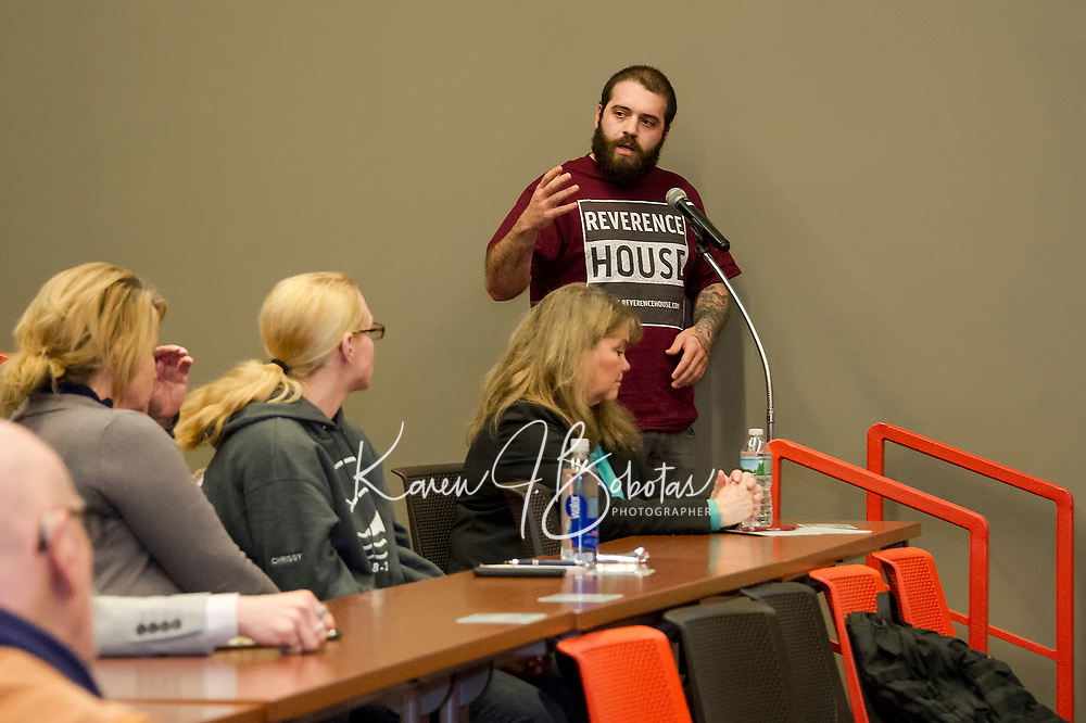 Adam Moulton presents questions to the audience and panel during the substance abuse forum held Thursday evening at Lakes Region Community College.  (Karen Bobotas/for the Laconia Daily Sun)