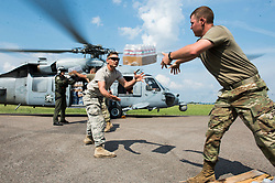 U.S. Soldiers and Sailors load water onto a U.S. Navy MH-60S Sea Hawk helicopter in Beaumont, Texas, Sept. 3, 2017. Hurricane Harvey formed in the Gulf of Mexico and made landfall in southeastern Texas, bringing record flooding and destruction to the region. U.S. military assets supported FEMA as well as state and local authorities in rescue and relief efforts.<br /><br />(U.S. Air Force photo by Tech. Sgt. Larry E. Reid Jr.)  Please note: Fees charged by the agency are for the agency's services only, and do not, nor are they intended to, convey to the user any ownership of Copyright or License in the material. The agency does not claim any ownership including but not limited to Copyright or License in the attached material. By publishing this material you expressly agree to indemnify and to hold the agency and its directors, shareholders and employees harmless from any loss, claims, damages, demands, expenses (including legal fees), or any causes of action or allegation against the agency arising out of or connected in any way with publication of the material.