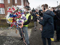 © Licensed to London News Pictures. 11/04/2018. London, UK. A man who gave his name as Iain Gordon is surrounded by reporters as he removes floral tributes from near the house of Richard Osborn-Brooks. Henry Vincent was killed as he burgled the home of 78 year old Richard Osborn-Brooks. Mr Osborn-Brooks was arrested for murder but later released without charge. Friends and family of Henry Vincent have had floral tributes they placed near the scene repeatedly torn down by locals. Photo credit: Peter Macdiarmid/LNP