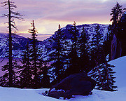 Winter sunset over southern shore of Crater Lake, Crater Lake National Park, Oregon.