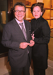 MR & MRS JOSEPH ETTEDGUI, he is designer Joseph, at a party in London on 24th February 1998.MFP 18