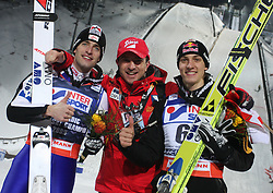Austria's head coach Alexander Pointner (C) poses with winner Wolfgang Loitzl (L) and second placed compatriot Gregor Schlierenzauer (R) after the men's HS 100 ski jumping competition  at FIS Nordic World Ski Championships Liberec 2008, on February 21, 2009, in Jested, Liberec, Czech Republic. (Photo by Vid Ponikvar / Sportida)