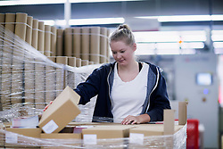 Young woman working in books printing industry, Bremgarten, Hartheim am Rhein, Baden-W¸rttemberg, Germany