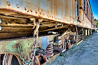 View of an old rusted train abandoned in a track.