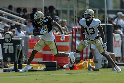 July 28, 2018 - Metairie, LA, U.S. - METAIRIE, LA. - JULY 28:  New Orleans Saints wide receiver Ted Ginn Jr. (19) and defensive back Marcus Williams (43) run through a drill during New Orleans Saints training camp practice on July 28, 2018 at the Ochsner Sports Performance Center in New Orleans, LA.  (Photo by Stephen Lew/Icon Sportswire) (Credit Image: © Stephen Lew/Icon SMI via ZUMA Press)