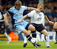 25/9/2004<br />FA Barclays Premiership - Fulham v Southampton - Craven Cottage<br />Fulham's Mark Pembridge and Southampton captain James Beattie man handle eachother in a bid to win possession.<br />Photo:Jed Leicester/BPI (back page images)
