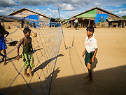 06 NOVEMBER 2014 - SITTWE, RAKHINE, MYANMAR: Children in a Rohingya Muslim IDP camp play takraw in their camp. After sectarian violence devastated Rohingya communities and left hundreds of Rohingya dead in 2012, the government of Myanmar forced more than 140,000 Rohingya Muslims who used to live in and around Sittwe, Myanmar, into squalid Internal Displaced Persons camps.The government says the Rohingya are not Burmese citizens, that they are illegal immigrants from Bangladesh. The Bangladesh government says the Rohingya are Burmese and the Rohingya insist that they have lived in Burma for generations.  The camps are about 20 minutes from Sittwe but the Rohingya who live in the camps are not allowed to leave without government permission. They are not allowed to work outside the camps, they are not allowed to go to Sittwe to use the hospital, go to school or do business. The camps have no electricity. Water is delivered through community wells. There are small schools funded by NOGs in the camps and a few private clinics but medical care is costly and not reliable.   PHOTO BY JACK KURTZ