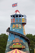 Father and son on a helter skelter at the Suffolk Show on the 29th May 2019 in Ipswich in the United Kingdom. The Suffolk Show is an annual show that takes place in Trinity Park, Ipswich in the English county of Suffolk. It is organised by the Suffolk Agricultural Association.