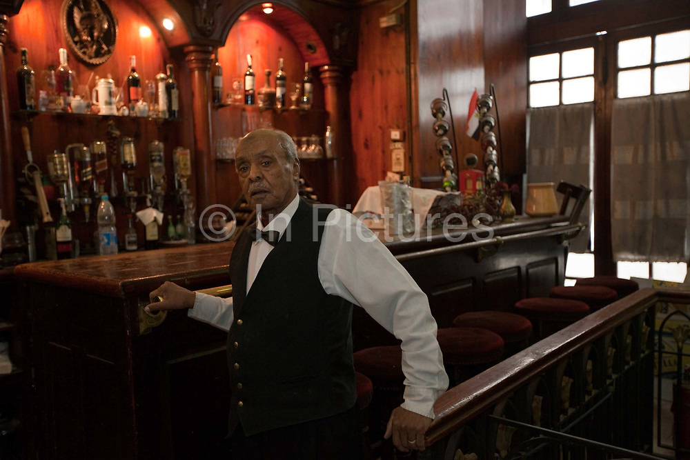 Fil Fil, a waiter who has worked in Cafe Riche since 1943, Cairo, Egypt