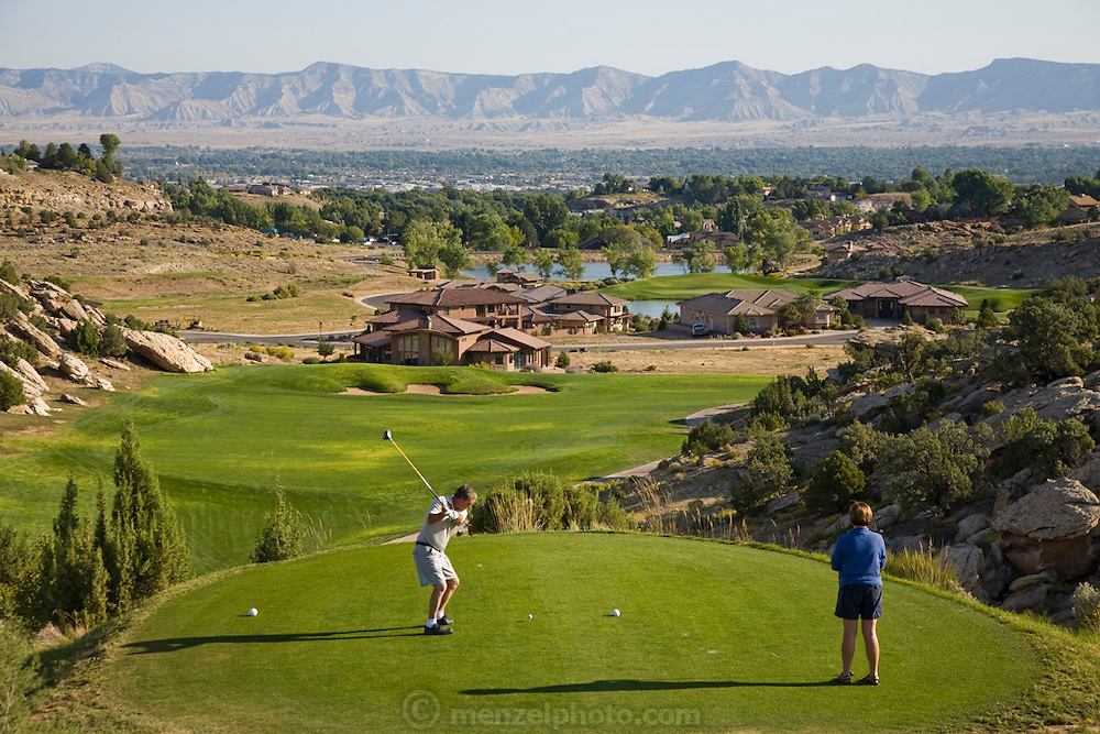 Golfers tee-off at The Golf Club at Redlands Mesa in Grand Junction, Colorado, where Bob Sorensen works as a greens keeper. (Bob Sorensen is featured in  the book What I Eat: Around the World in 80 Diets.)