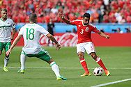 Neil Taylor of Wales ® looks to play a pass past Aaron Hughes of Northern Ireland. UEFA Euro 2016, last 16 , Wales v Northern Ireland at the Parc des Princes in Paris, France on Saturday 25th June 2016, pic by  Andrew Orchard, Andrew Orchard sports photography.
