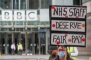 """NHS workers accused the BBC of holding back the information over the NHS pay rise during a protest on Saturday, Sept 12, 2020 - outside the BBC Broadcasting House in London. Grassroot NHS workers are angry after they were left out of plans to give almost a million to public sector workers an above-inflation increase. Ministers say they were working with unions to ensure the """"best possible"""" pay package for all health workers. (VXP Photo/ Vudi Xhymshiti)"""