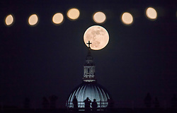 © Licensed to London News Pictures. 31/01/2018. London, UK. Lights from the Embankment are seen above St Paul's Cathedral in central London as a full, blue supermoon rises shortly after sunset. Two full moons in the same calendar month is also know as a blue moon. Photo credit: Ben Cawthra/LNP