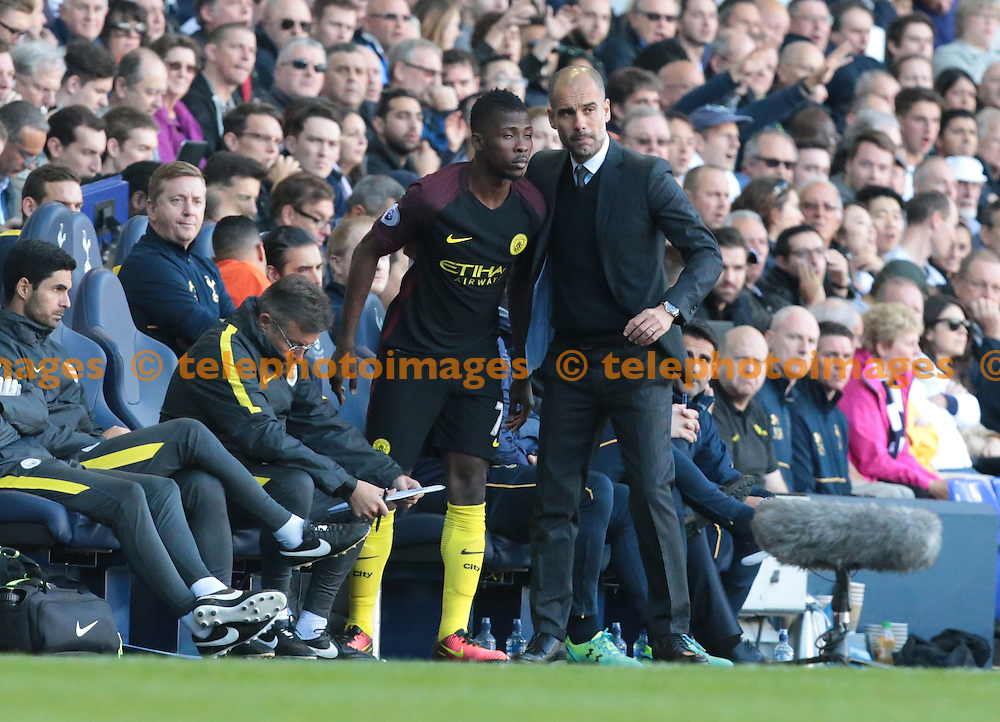 Manchester City manager Pep Guardiola  haveng words with Manchester City's Kelechi Iheanacho<br /> during the Premier League match between Tottenham Hotspur and Manchester City at White Hart Lane in London. October 1, 2016.<br /> James Galvin / Telephoto Images<br /> +44 7967 642437