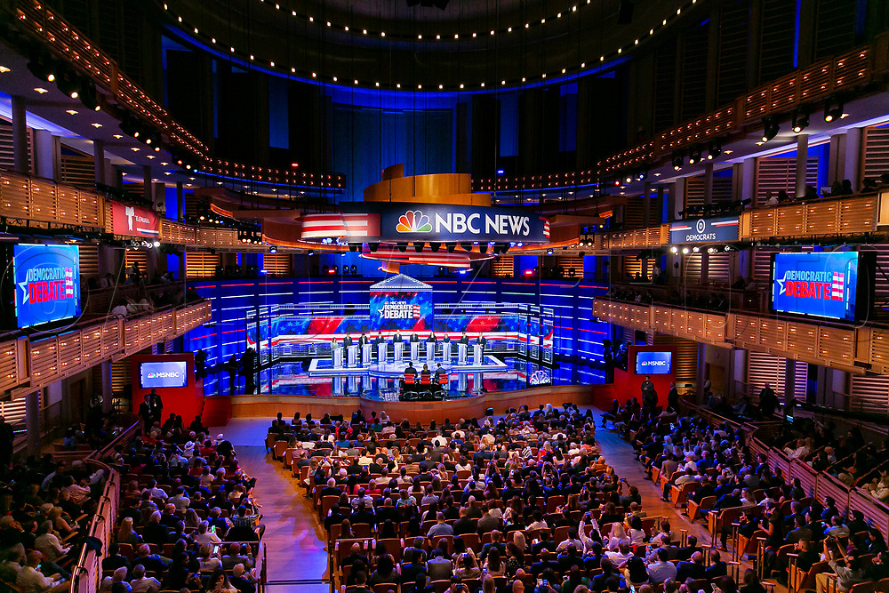 Democratic presidential candidates wave to the crowd before the start of the first primary debate for the 2020 elections at the Adrienne Arsht Center for the Performing Arts in downtown Miami on Thursday, June 27, 2019.