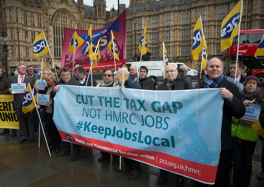 © Licensed to London News Pictures. 01/03/2016. London, UK. Members of the PCS union highlight the closure of HMRC tax offices in a protest near Parliament.   Photo credit: Peter Macdiarmid/LNP
