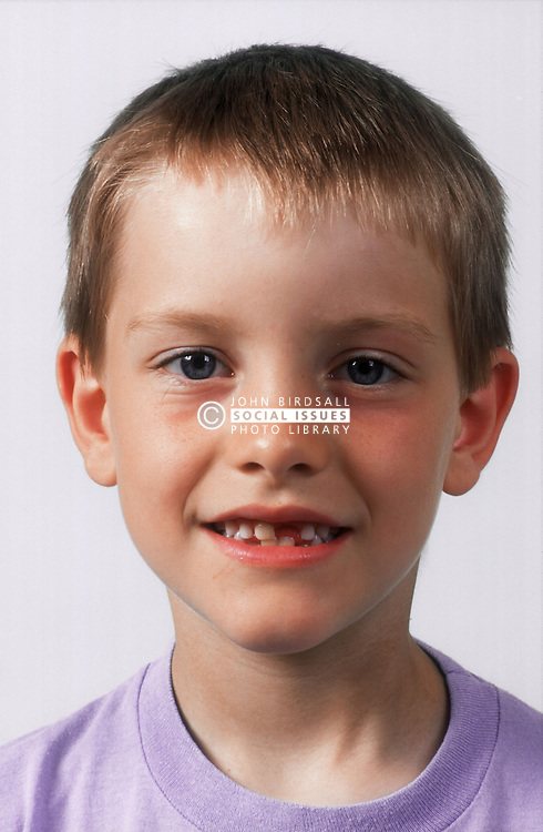 Portrait of young boy smiling,
