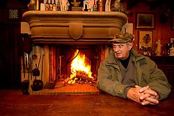 """Ain (01) 16/03/06, Le chef Paul Bocuse, assis a une table au coin du feu, dans sa """"cabane"""" pres de l'etang dans son domaine des Dombes High cuisine chef Paul Bose died at 91 it was announced on Saturday. Photo by Soudan/ANDBZ/ABACAPRESS.COM"""