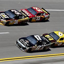 April 17, 2011; Talladega, AL, USA; NASCAR Sprint Cup Series driver Clint Bowyer (33) drafts Jeff Burton (31) and David Ragan (6) drafts Matt Kenseth (17) during the Aarons 499 at Talladega Superspeedway.   Mandatory Credit: Derick E. Hingle