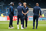 Portsmouth players arrive to inspect the pitch during the EFL Sky Bet League 1 match between Wycombe Wanderers and Portsmouth at Adams Park, High Wycombe, England on 6 April 2019.