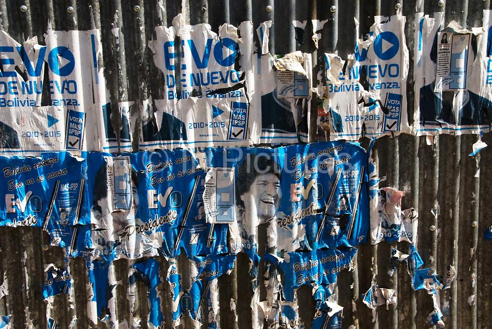 Oruro. Peeling posters of President Evo Morales.