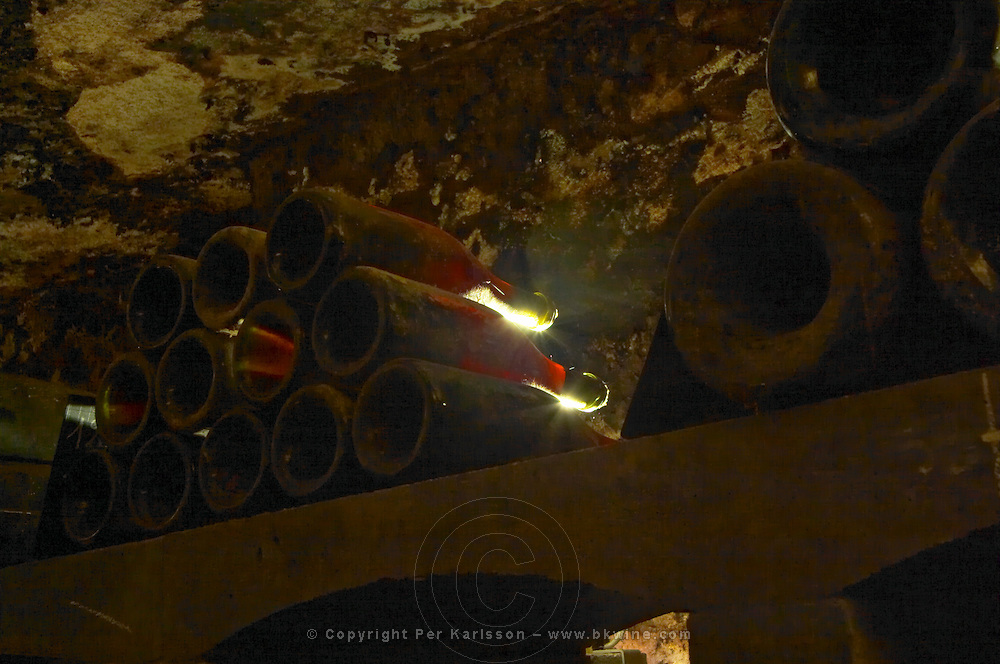 In the underground wine cellar: lying bottles in the treasure chamber where the oldest bottles are kept. Red Burgundy wine vaulted vault ceiling with contrasting lights, Maison Louis Jadot, Beaune Côte Cote d Or Bourgogne Burgundy Burgundian France French Europe European