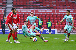 Matt Grimes of Swansea City is pressured by Cyrus Christie of Nottingham Forest  - Mandatory by-line: Nick Browning/JMP - 29/11/2020 - FOOTBALL - The City Ground - Nottingham, England - Nottingham Forest v Swansea City - Sky Bet Championship