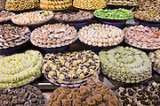 A colorful display of Moroccan specialty sweets on sale in the market, Meknes, Morocco.