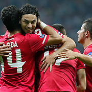 Turkey's Arda TURAN (L) celebrates after scoring against Kazakhstan during their Euro 2012 Group A qualifying soccer match at Turk Telekom Arena in Istanbul September 2, 2011. Photo by TURKPIX