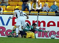 Fotball, 23. mai 204, Tippeligaen, Lillestrøm-Sogndal,  Robert Koren, Lillestrøm, ligger nede. Til venstre Kjetil Holvik, Sogndal, som feldte Koren innenfor 16-meteren. Til Høyre  Terje Skjeldestad, Sogndal