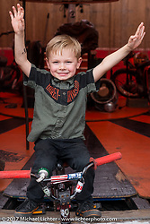 Deegan Ives, son of Wall Of Death rider Kyle Ives, is a daredevil in the making as he grows up in and around the family wall. The Ives Brothers perform daily at the Harley-Davidson dispay at the Daytona Speedway during Daytona Bike Week. Daytona Beach, FL. USA. Monday March 13, 2017. Photography ©2017 Michael Lichter.