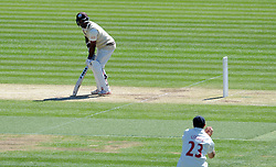Dejection for Surrey's Kumar Sangakkara as he is caught by Glamorgan's Dean Cosker.- Photo mandatory by-line: Harry Trump/JMP - Mobile: 07966 386802 - 22/04/15 - SPORT - CRICKET - LVCC County Championship - Division 2 - Day 4 - Glamorgan v Surrey - Swalec Stadium, Cardiff, Wales.
