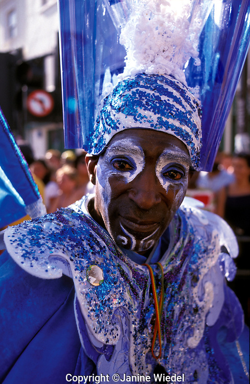 Notting Hill carnival parading through central  London streets in August.