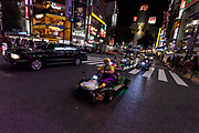 Western tourists enjoy touring Tokyo on go carts run by Mari Cart company. Shibuya, Tokyo, Japan Friday September 15th 2017 The carts that trade on the Super Mario Carts game idea and charters are a popular tourist attraction in Tokyo. Though there are safety and copyright issues that may soon force the company to stop running the tours