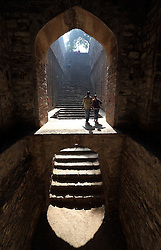 © Licenced to London News Pictures. 17//11/2014. Delhi. India.  <br /> Young people enjoy the serenity of the 'Agrasen ki Baoli' ancient water temple monument in Delhi, India, November 17th 2014.<br /> Photo Credit: Susannah Ireland