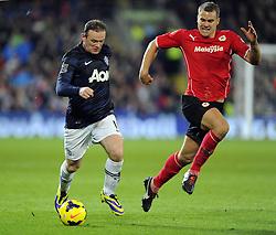 Man Utd Forward Wayne Rooney (ENG) battles for the ball with Cardiff City Defender, Ben Turner (ENG) - Photo mandatory by-line: Joseph Meredith/JMP - Tel: Mobile: 07966 386802 - 24/11/2013 - SPORT - FOOTBALL - Cardiff City Stadium - Cardiff City v Manchester United - Barclays Premier League.