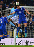 Harry Maguire of Leicester and Tosin Adarabioyo of Manchester City jump for the ball .Carabao Cup quarter final match, Leicester City v Manchester City at the King Power Stadium in Leicester, Leicestershire on Tuesday 19th December 2017.<br /> pic by Bradley Collyer, Andrew Orchard sports photography.