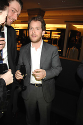 Left to right, ALEX JAMES and TOM HOLLANDER at a party to celebrate the 5th anniversary of Grand Classics held at the Dom Perignon OEnotheque Bar at Harrods, Knightsbridge, London on 14th February 2008.<br />