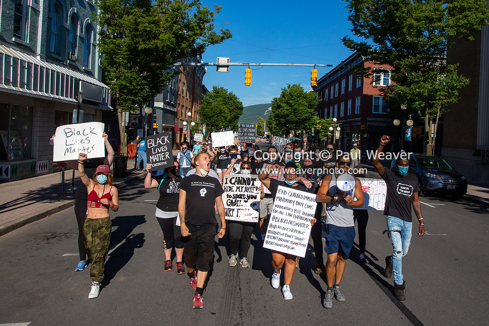 Several dozen Black Lives Matter protesters march down East Main Street in Lock Haven, PA.