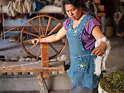 Juana Gutierrez Contreras spinning churro sheep wool in her natural dyes studio in the Zapotec village of Teotitlan del Valle, Oaxaca, Mexico on 25 November 2018. The handspun yarn comes from the nearby mountain village of Chichicapa