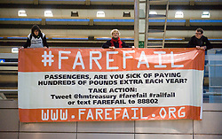 © Licensed to London News Pictures. 03/01/2012. London, UK.  Protest group Fairfail led by the TSSA union demonstrate inside St Pancras Train Station in London on January 1st, 2012, against the cost of rail fairs in the UK. Photo credit : Ben Cawthra/LNP