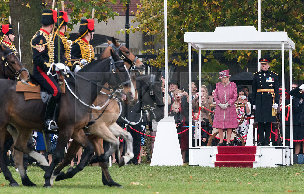 © Licensed to London News Pictures. 19/10/2017. London, UK. Queen Elizabeth II reviews The King's Troop Royal Horse<br /> Artillery in Hyde Park, on the occasion of their 70th Anniversary. The KTRHA was formed on the wishes of His Majesty King George VI in October 1947. Commonly known as the ëGunnersí, The Royal Artillery provides firepower to the British Army. Equipped with 13-pounder field guns dating from WWI, the Troop provides ceremonial salutes for Royal occasions and state functions. Photo credit: Ray Tang/LNP