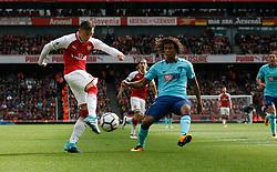 09 September 2017 London : Premier League Football : Arsenal v Bournemouth : Nathan Ake can only watch as Mesut Ozil of Arsenal shoots.<br /> Photo: Mark Leech