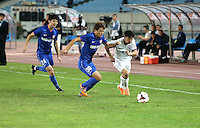 Zhan Yilin of Shanghai Shenhua, right, challenges Yoon Sin-young of Jiangsu Sainty, center, during their 28th round match of the 2014 Chinese Football Association Super League in Nanjing city, east China's Jiangsu province, 18 October 2014.<br /> <br /> Jiangsu Sainty drew with Shanghai Shenhua 1-1.