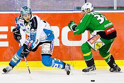 Martin Grabher Meier (EHC Liwest Linz, #91) and Eric Pance (HDD Tilia Olimpija, #30) during ice-hockey match between HDD Tilia Olimpija and EHC Liwest Black Wings Linz at fourth match in Semifinal  of EBEL league, on March 13, 2012 at Hala Tivoli, Ljubljana, Slovenia. (Photo By Matic Klansek Velej / Sportida)