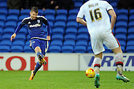 Cardiff City's Anthony Pilkington (L) shoots at goal. Skybet football league championship match, Cardiff city v MK Dons at the Cardiff city stadium in Cardiff, South Wales on Saturday 6th February 2016.<br /> pic by Carl Robertson, Andrew Orchard sports photography.
