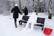 Local people out and about enjoying the snow, and building a snow man figure in Kings Heath Park on 24th January 2021 in Birmingham, United Kingdom. Deep snow arrived in the Midlands giving some light relief and fun during the current lockdown for people who simply enjoyed the weather.