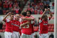 Photo: Lee Earle.<br /> Swindon Town v Port Vale. Coca Cola League 1. 08/10/2005. Swindon players congratulate Rory Fallon (C) after his opening goal.