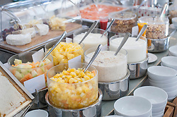 Close-up of fruits and cereals at breakfast buffet